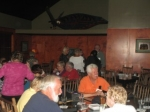 Karla's Warren Weir (in orange) at Friday night fish fry and Tom Smith (left foreground)